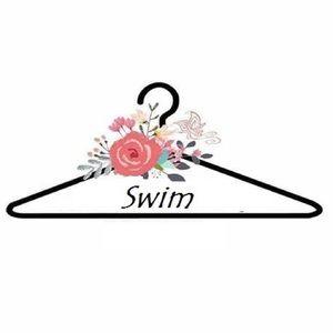 Swimwear!!!! Sarongs one pieces tankinis and more